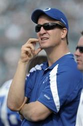 In this Jan. 1, 2012, file photo, Indianapolis Colts quarterback Peyton Manning watches from the sideline during the first half of a game.