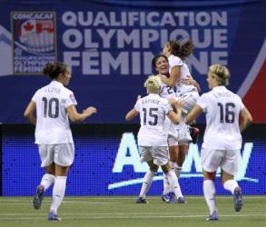 United States' Abby Wambach (20) celebrates her goal against Canada with teammates during the first half of a CONCACAF women's Olympic qualifying match in Vancouver Sunday.