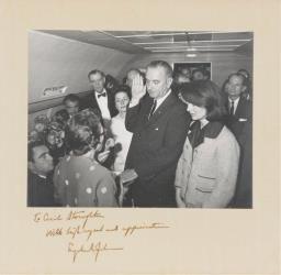 Lyndon Johnson is sworn in aboard Air Force One following John F. Kennedy's assassination, Nov. 22, 1963.