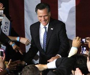 Mitt Romney, takes the stage to celebrate his Florida primary election win at the Tampa Convention Center in Tampa, Fla., Tuesday, Jan. 31, 2012.