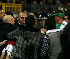 Egyptian police clash with fans after a football match between Al-Ahly and Al-Masry teams in Port Said, Egypt, February 1, 2012.