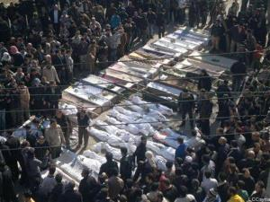 In this citizen journalism image, Syrian mourners gather around the coffins of the victims who were killed early Saturday, in Khaldiyeh neighborhood in Homs province, on Feb. 4, 2012.