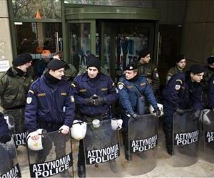 Police stand guard on February 8, 2012 in front of the Ministry of Development occupied by Public Power company unionists in Athens.
