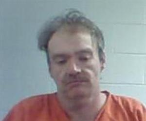 Jamie Curd, 38, has been charged as an accessory to the slayings.