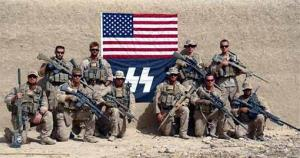 Sniper scouts from Charlie Company, 1st Reconnaissance Battalion, pose for a photo in Afghanistan in front of an SS flag.