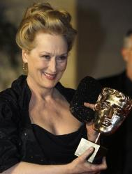 Meryl Streep poses with her 'Best Actress' award for her role in 'The Iron Lady' in London.