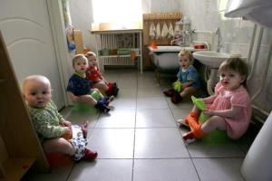 Kids with HIV sit on potties in a Moscow orphanage.