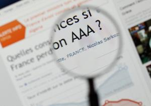 France has kept its triple-A rating with Moody's, but the agency has revised its outlook to 'negative.'