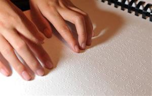 Winona Brackett, 12, read from her Braille science school book on Wednesday, March 25, 2009, in Stuart, Fla.