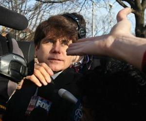 Former Illinois Governor Rod Blagojevich greets supporters outside his home after returning from his sentencing hearing December 7, 2011 in Chicago, Illinois.