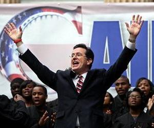 Stephen Colbert sings to the crowd during the Rock Me Like a Herman Cain South Cain-olina Primary Rally, Jan. 20, 2012.