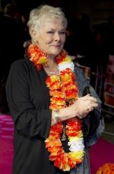 British actress Dame Judi Dench arrives for the World Premiere of The Best Exotic Marigold Hotel at a Mayfair cinema in London, Tuesday, Feb. 7, 2012.