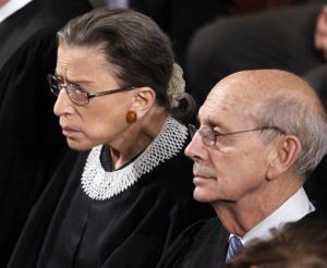 Supreme Court Justices Ruth Bader Ginsburg and Stephen Breyer listen to President Barack Obama's State of the Union address on Capitol Hill in Washington, Tuesday, Jan. 24, 2012.