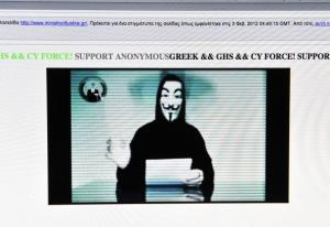 This picture taken on February 3, 2012 shows a photograph of the Greek ministry of justice website, hacked by Anonymous.