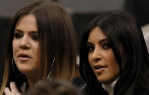 Khloe and Kim Kardashian attend a game between the Phoenix Suns and the Dallas Mavericks at American Airlines Center on January 4, 2012 in Dallas, Texas.