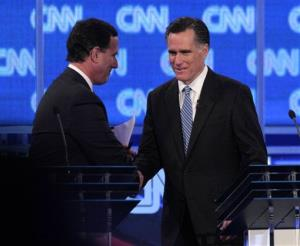 Former Pennsylvania Sen. Rick Santorum and former Massachusetts Gov. Mitt Romney shake hands at the end of the Republican presidential candidate debate in Charleston, S.C., Thursday, Jan. 19, 2012.