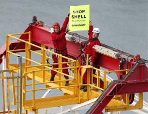 Lucy Lawless, left, joins activists on the drilling vessel.