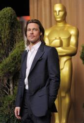 Brad Pitt, a Best Actor nominee for Moneyball, poses at the 31st Academy Awards Nominees Luncheon in Beverly Hills, Calif., Monday, Feb. 6, 2012.