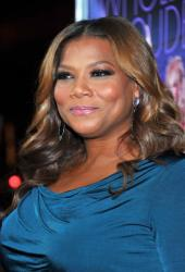 A smiling Queen Latifah poses at the premiere of Warner Bros. Joyful Noise in Hollywood last month.