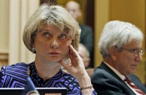 State Sen. Janet Howell, D-Fairfax, left, looks at the vote tally board at the Capitol in Richmond, Va., Tuesday.