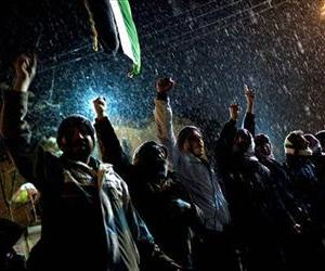 Free Syrian Army supporters chant anti government slogans under snowfall on the outskirts of Idlib , north Syria,  Wednesday, Feb. 29, 2012.