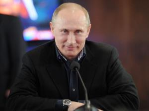 Vladimir Putin smiles as he visits his campaign staff in Moscow, late on March 4, 2012.