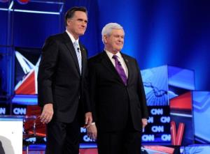 Mitt Romney and Newt Gingrich are introduced during a debate sponsored by CNN and the Republican Party of Arizona at the Mesa Arts Center February 22, 2012 in Mesa, Arizona.