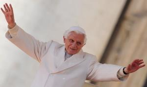 Pope Benedict XVI waves as he takes his place for his weekly general audience on March 7, 2012 at St Peter's square at the Vatican.