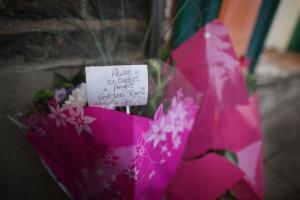 Floral tributes are left close to the spot where a torso was found in Regents Canal in London.
