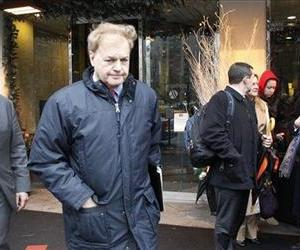 James Giddens, the court-appointed trustee for MF Global, Inc., leaves a meeting held with customers of MF Global, Thursday, Jan. 12, 2012 in New York.