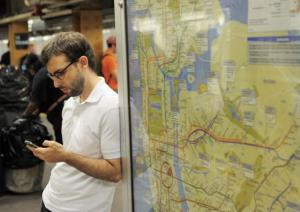 A man checks his cell phone on a subway platform in the Union Square station of the L line on September 27, 2011 in New York.