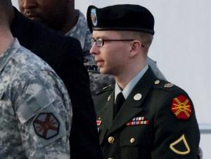 US Army Private First Class Bradley Manning (R) is escorted by military police to a vehicle after his arraignment at Fort Meade, Maryland, on February 23, 2012.