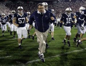 In this Oct. 27, 2007 file photo, 80-year-old Penn State coach Joe Paterno runs onto the field with his team before a game against Ohio State.