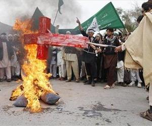 Afghans burn an effigy following Sunday's killing of civilians in Panjwai,  Kandahar by a US soldier during a protest in Jalalabad east of Kabul, Afghanistan, Tuesday, March 13, 2012.