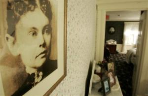 In this Aug. 20, 2008, file photo, a photograph of Lizzie Borden hangs on a wall in the Lizzie Borden Bed and Breakfast, in Fall River, Mass.