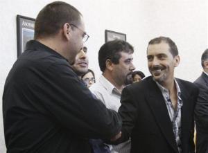 Plantiffs Carlos Fernandes, right, Candido Silva Jr. shake hands after the verdict yesterday.