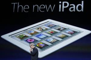 In this March 7, 2012 file photo, Apple CEO Tim Cook clasp his hands during an new iPad announcement during an Apple event in San Francisco.