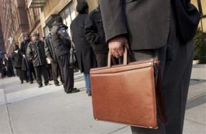 Dozens of job seekers line up to enter a National Career Fair in New York last month.
