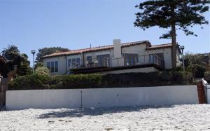 In this April 7, 2010 photo, the oceanfront home owned by former Massachusetts Gov. and Republican presidential hopeful Mitt Romney is seen in the La Jolla section of San Diego.