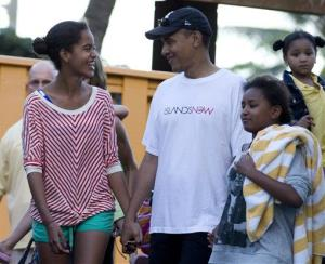 President Barack Obama holds hands with his daughters Malia, left, and Sasha, right, as they leave Sea Life Park, a marine wildlife park, with family friends, Dec. 27, 2011, in Waimanalo, Hawaii.