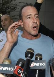 Michael Lohan, father of actress Lindsay Lohan, gestures as he speaks to the media after being released from the Hillsborough County Jail Wednesday, Oct. 26, 2011, Tampa, Fla.