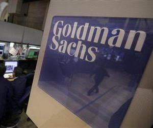 Traders work in the Goldman Sachs booth on the floor of the New York Stock Exchange Thursday, March 15, 2012.