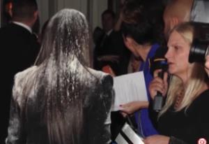 Kim Kardashian gets flour-bombed.