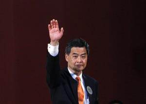 Leung Chun-ying waves as he celebrated after winning the chief executive election in Hong Kong earlier today.