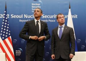 President Obama and Russian President Dmitry Medvedev stand together at the end of a bilateral meeting at the Nuclear Security Summit in Seoul, South Korea, Monday, March 26, 2012.