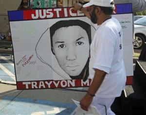 A Houston resident carries a sign during a solidarity rally for Trayvon Martin.