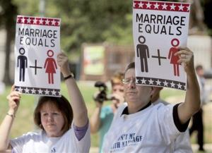 Stan, right, and Martha Harper from Wendell, NC, hold signs in support of the National Organization for Marriage Tuesday, Aug. 10, 2010 in Raleigh, NC.