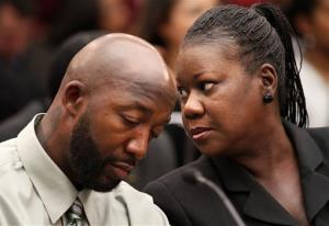 Trayvon Martin's parents, Tracy Martin, left, and Sybrina Fulton, attend a House Judiciary Committee briefing Tuesday.
