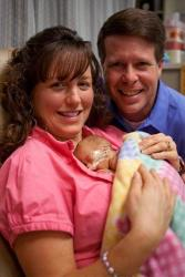 Jim Bob and Michelle Duggar hold their 19th baby, daughter Josie Brooklyn Duggar, last year.