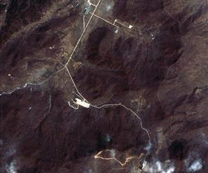 This March 28 satellite image shows North Korea's Tongchang-ri Launch Facility, including the launch pad, center left,  the rocket engine test stand, bottom, and the assembly building, top in green.